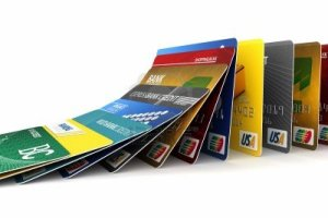 10286298-fake-credit-cards-in-a-row-falling-credit-card-debt-concept